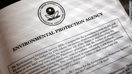 FILE - In this March 16, 2017, file photo, proposals for the Environmental Protection Agency (EPA) in President Donald Trump's first budget are displayed at the Government Printing Office in Washington. President Donald Trump will sign an executive order on March 29 that will suspend, rescind, or flag for review more than half-a-dozen measures that were part of former President Barack Obama's sweeping plan to curb global warming. (AP Photo/J. Scott Applewhite, file)