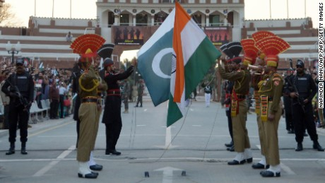 Indian and Pakistani border guards engage in a daily flag-lowering ceremony.