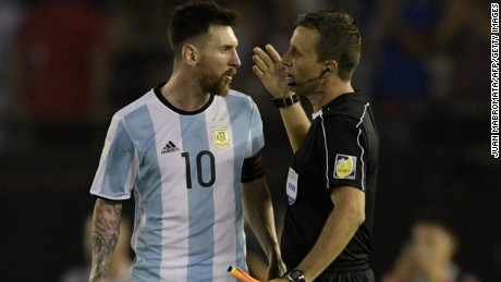 Argentina's Lionel Messi speaks with the linesman during their 2018 FIFA World Cup qualifier football match against Chile at the Monumental stadium in Buenos Aires, Argentina, on March 23, 2017. / AFP PHOTO / Juan Mabromata        (Photo credit should read JUAN MABROMATA/AFP/Getty Images)