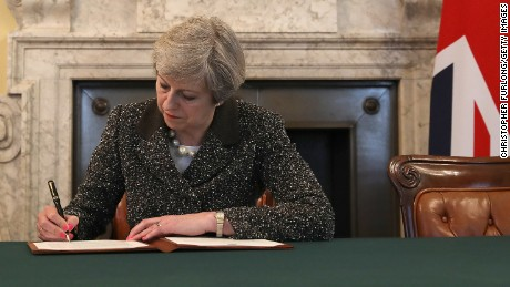British Prime Minister Theresa May signs the official letter to European Council President Donald Tusk invoking Article 50 and triggering the Brexit process on March 28, 2017.