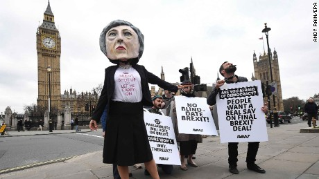 Protesters outside Parliament in London criticize Prime Minister Theresa May's Brexit approach on Wednesday.