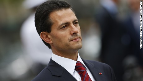 Mexican President Enrique Pena Nieto attends a wreath laying ceremony on the tomb of the unknown soldier at the Arc de Triomphe monument in Paris, on Bastille Day, July 14, 2015. AFP PHOTO / POOL / THOMAS SAMSON        (Photo credit should read THOMAS SAMSON/AFP/Getty Images)