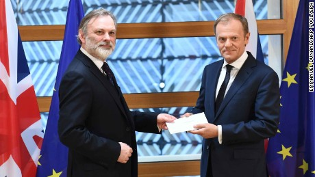 British ambassador to the EU, Sir Tim Barrow,  delivers the official Article 50 notice to European Council President Donald Tusk in Brussels.