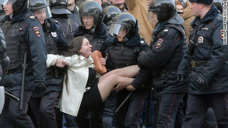 epa05871912 Russian riot policemen detain a demonstrator during an opposition rally in central Moscow, Russia, 26 March 2017. Russian opposition leader Alexei Navalny called on his supporters to join a demonstration in central Moscow despite a ban from Moscow authorities. Throughout Russia the opposition held the so-called anti-corruption rallies. According to reports, dozens of demonstrators have been detained across the country as they called for the resignation of Russian Prime Minister Dmitry Medvedev over corruption allegations.  EPA/MAXIM SHIPENKOV