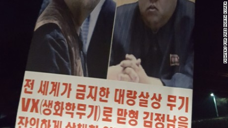 "A man holds a poster identifying Kim Jong Nam as ""the dead"" and Kim Jong Un as ""the murderer."" Under the photographs, it says ""ruthless barbarian Kim Jong-un who cruelly murdered the oldest brother, Kim Jong-nam with VX (Biochemical weapon) that the world has banned as a weapon of mass destruction."" Authorities in Malaysia say North Korea carried out the killing of Kim Jong Nam, the eldest half brother of North Korean leader Kim Jong Un. North Korea denies it."