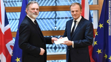 Britain's EU ambassador Tim Barrow delivers the Article 50 letter to European Council President Donald Tusk