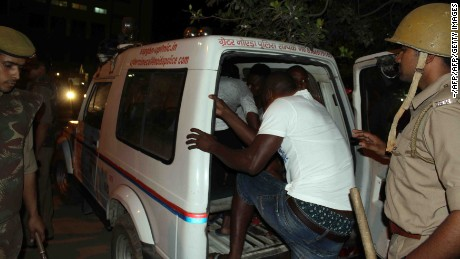 Indian police transport African nationals in Greater Noida, during a violent rampage by local residents.
