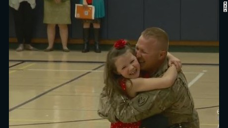 Military dad surprises daughter at school assembly.