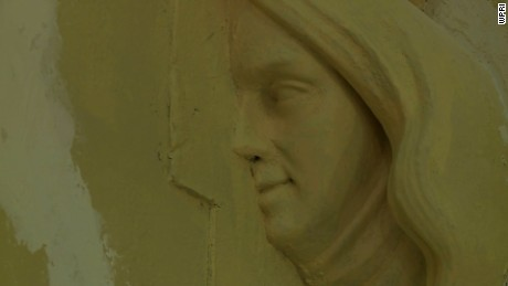 Mystery face uncovered behind church organ in Newport, Rhode Island