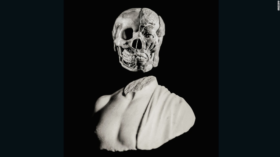 The Curiosity III cover image from the auction brochure features a striking juxtaposition of a wax anatomical model head from the late 18th or early 19th century estimate $23,195-$32,215 and a Roman marble bust 2nd century estimat