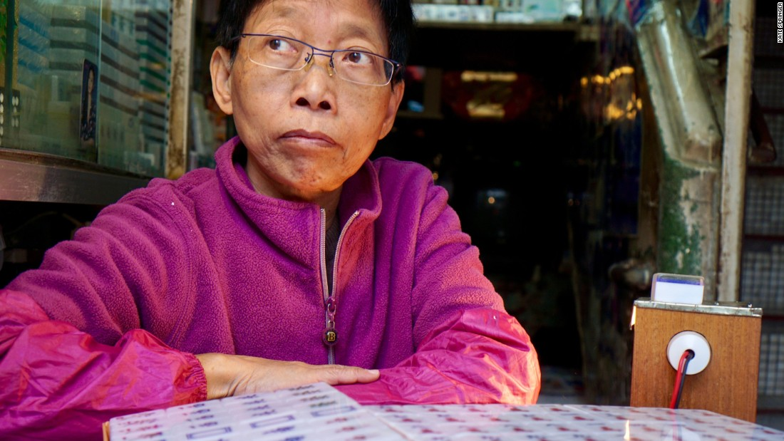 <strong>A dying industry:</strong> Ho, 59 years old, is one of Hong Kong's last mahjong tile carvers. She started carving when she was just 13 years old and now runs her family shop.