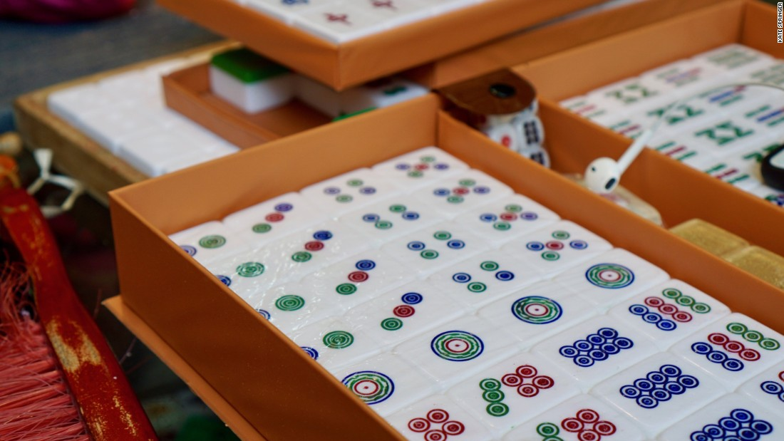 <strong>What's in a set?</strong> A four-person Hong Kong mahjong set comprises 144 pieces, including the four suits -- bamboo, dots, characters, directional winds -- and special tiles like flowers, seasons and dragons.