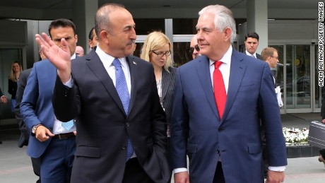 Turkey's Foreign Minister Mevlut Cavusoglu and US Secretary of State Rex Tillerson arrive for a meeting on March 30, 2017 in Ankara. Tillerson met Turkish leaders for talks clouded by differences over Syria, a day after Ankara announced the end of its military offensive there.