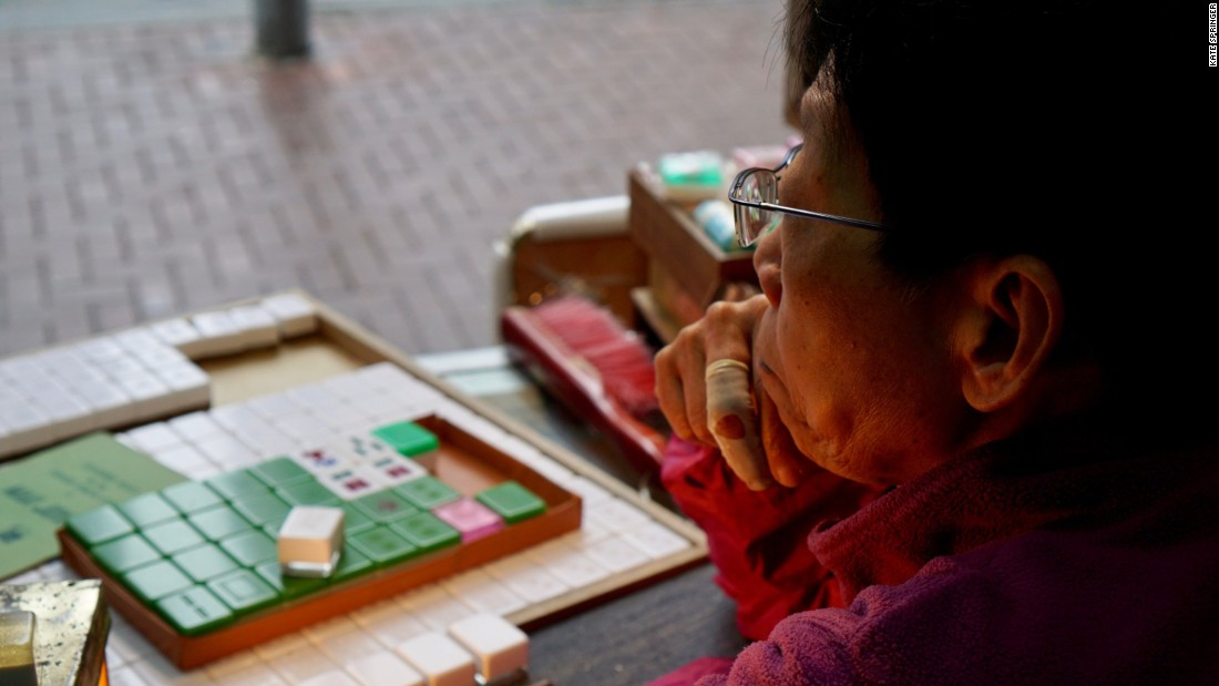 <strong>Kam Fat Mahjong: </strong>Tucked away in Hung Hom, Kam Fat Mahjong shop is a narrow, open-air space. There's not much to it, aside from a small work desk.