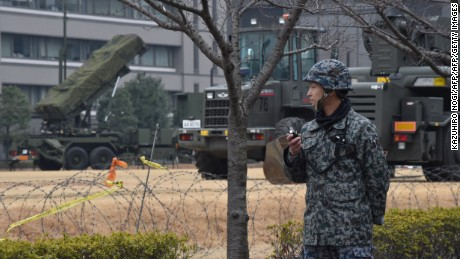 A Japan Self-Defense Forces soldier stands guard near a PAC-3 surface-to-air missile launcher unit, used to engage incoming ballistic missile threats, in position at the Defense Ministry in Tokyo on March 6, 2017.