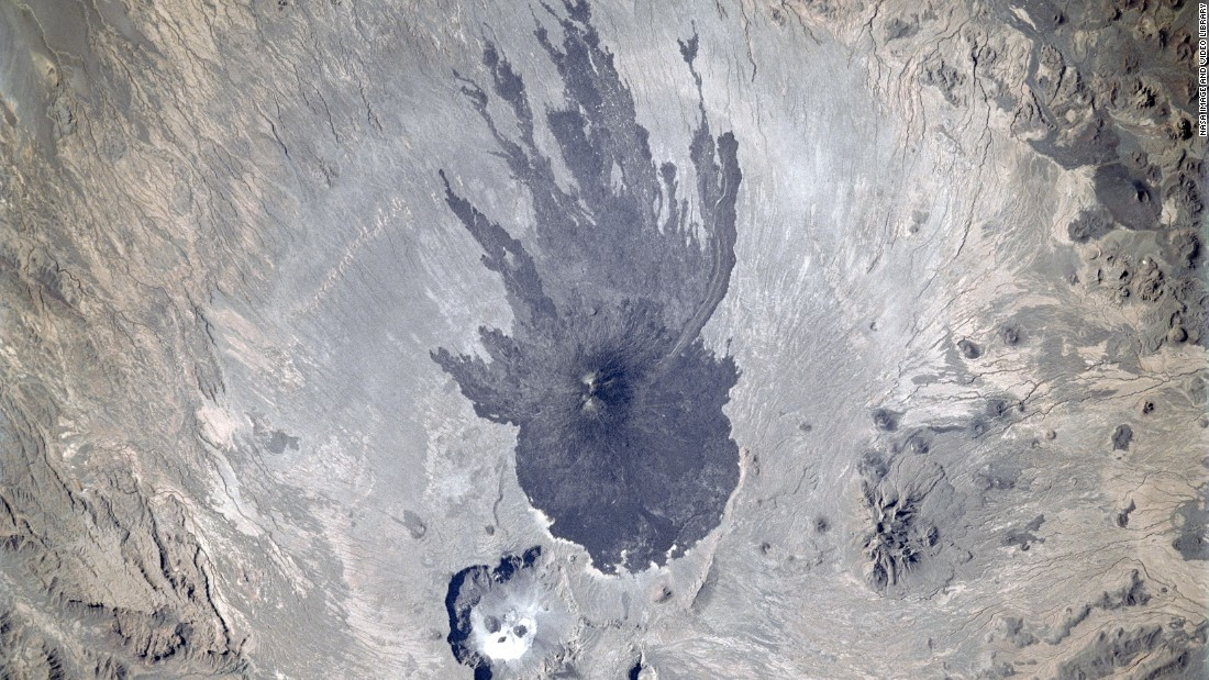 This image of the Tibesti Mountains, Chad, was taken in 1997. The squid-like shape the lava made as it flowed down the flanks of the Pic Tousside provided astronauts with a visual marker as they flew across northern Africa.