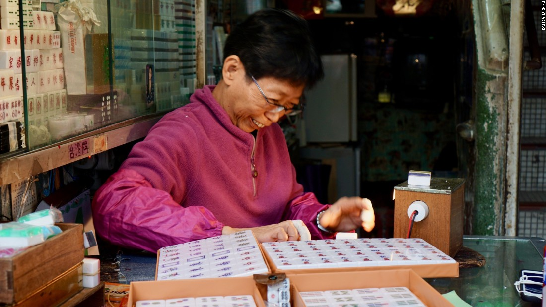 <strong>Preserving the past: </strong>Ho tells CNN that she can't make a living off mahjong tile carving. But she continues to work, because the shop contains my childhood memories and she wants to preserve the art.