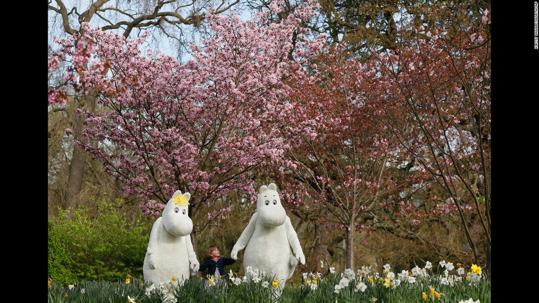 Sofia Lopez, 3, meets fictional characters Moominmamma, left, and Moomintroll at an Easter festival in London on Thursday, March 30. The Moomins are fairy-tale characters created by Finnish illustrator and writer Tove Jansson.