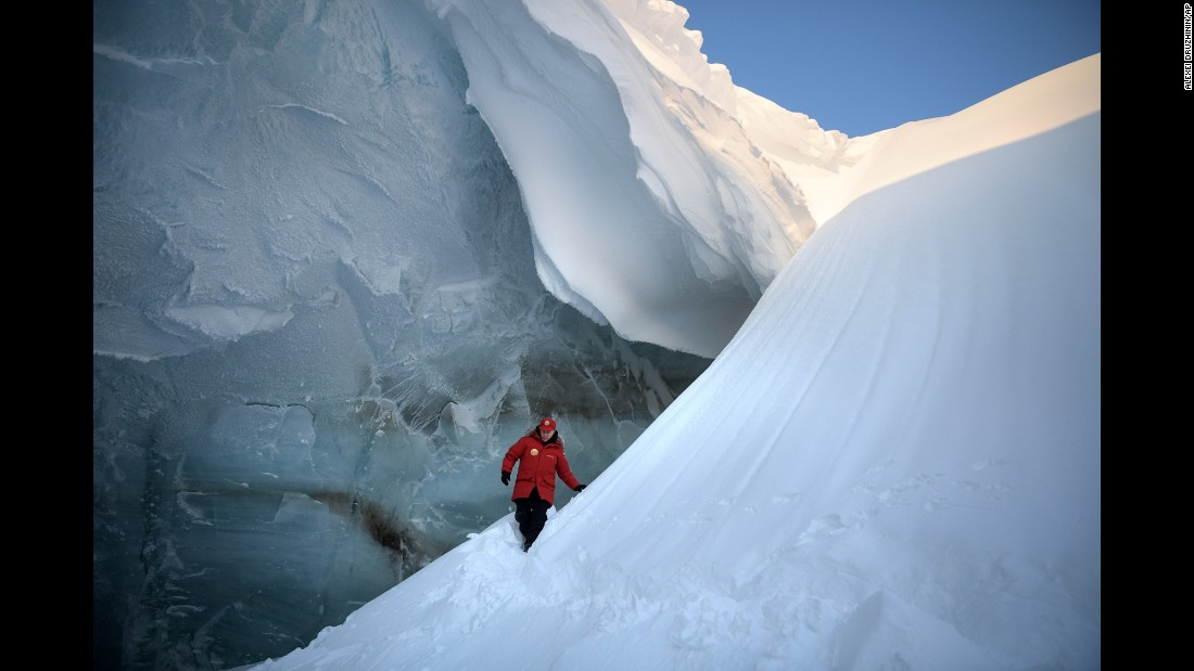 Russian President Vladimir Putin inspects a glacier crevasse on Franz Josef Land, a Russian archipelago in the Arctic, on Wednesday, March 29.