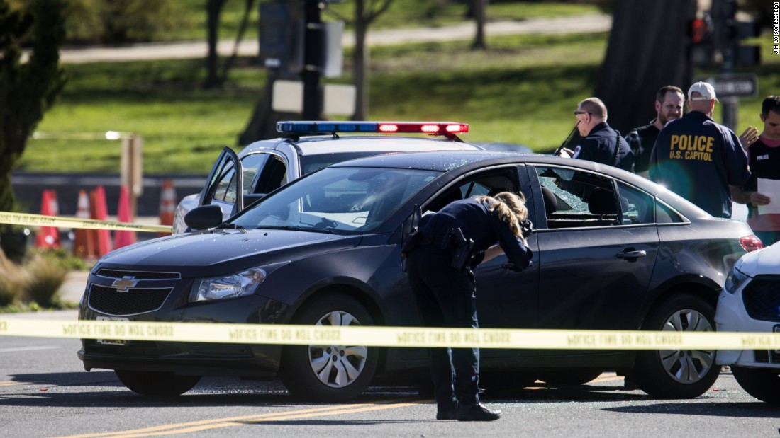 "Police surround a car that authorities say <a href=""http://www.cnn.com/2017/03/29/politics/capitol-building-driver/"" target=""_blank"">nearly struck Capitol Police officers</a> in Washington on Wednesday, March 29. The driver was taken into custody and charged with several crimes, including seven counts of assault on a police officer."