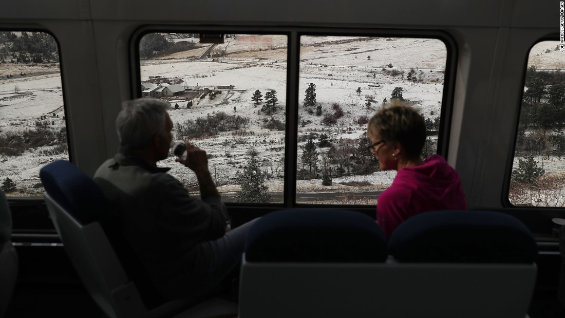 Passengers enjoy views of Denver as they ride on Amtrak's California Zephyr on Friday, March 24. The train's route runs from Chicago to the San Francisco Bay.