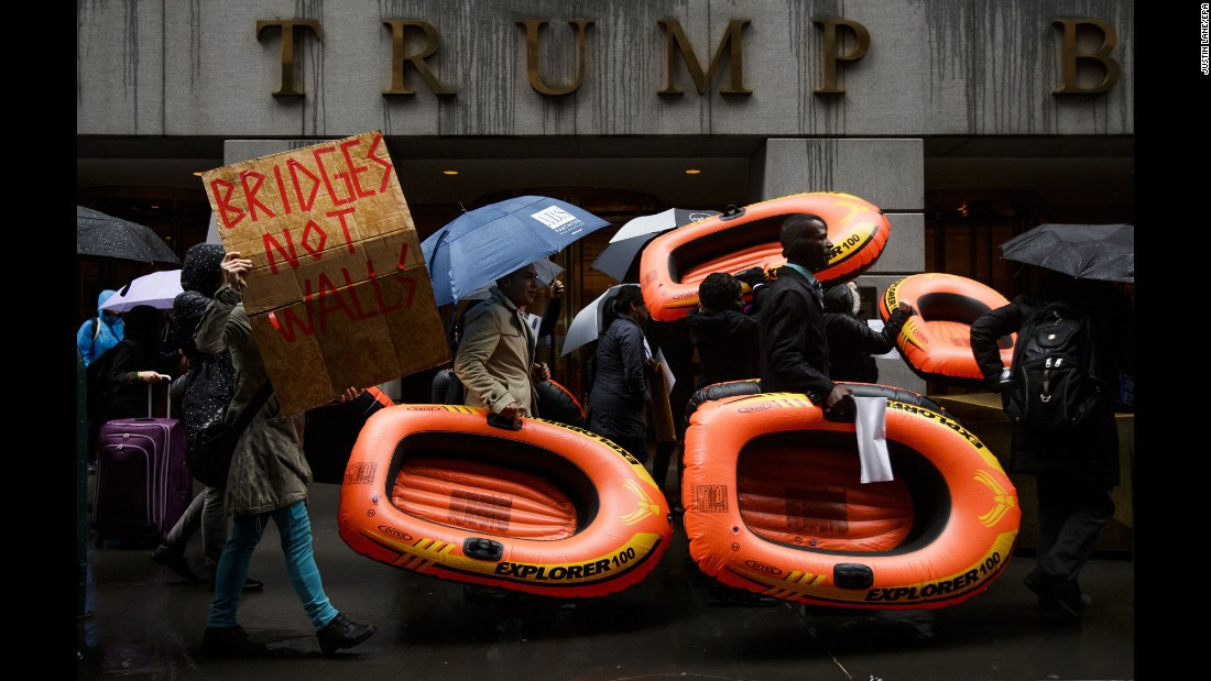 People carry inflatable rafts in front of New York's Trump Tower as they protest President Donald Trump's refugee policies on Tuesday, March 28.