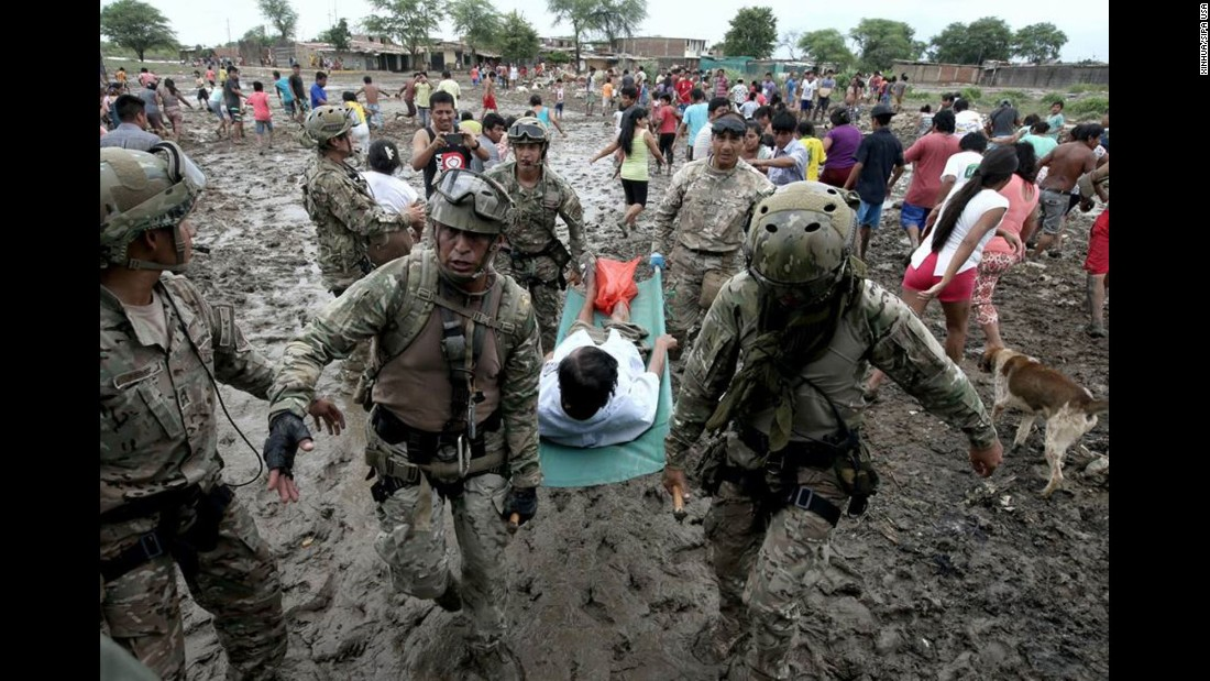 "Soldiers help with evacuations in Piura, Peru, on Wednesday, March 29. More than half a million people in and around the country's capital of Lima <a href=""http://www.cnn.com/2017/03/20/americas/peru-floods-mudslide-toll/"" target=""_blank"">have been affected by storms and flooding,</a> authorities said last week. Weeks of rain have caused rivers across the country to rise."