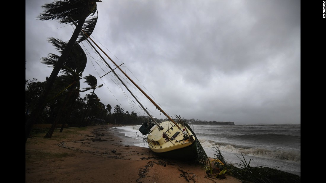 "A boat is washed ashore at Airlie Beach in Queensland, Australia, on Wednesday, March 29. Northeastern Australia is still dealing with <a href=""http://www.cnn.com/2017/03/30/asia/australia-cyclone-debbie-shark-flooding/"" target=""_blank"">the aftermath of Cyclone Debbie,</a> which swept across the Queensland coast and caused widespread damage."