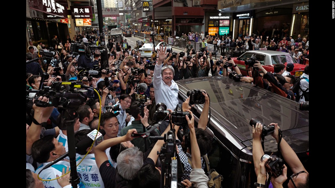 "John Tsang, a candidate for chief executive in Hong Kong, waves to supporters on Friday, March 24. <a href=""http://www.cnn.com/2017/03/25/asia/hong-kong-chief-executive/"" target=""_blank"">He finished second</a> to Carrie Lam, however, in a race decided by an election committee drawn mostly from Hong Kong's elite. <a href=""http://www.cnn.com/2017/03/23/world/gallery/week-in-photos-0324/index.html"" target=""_blank"">See last week in 28 photos</a>"