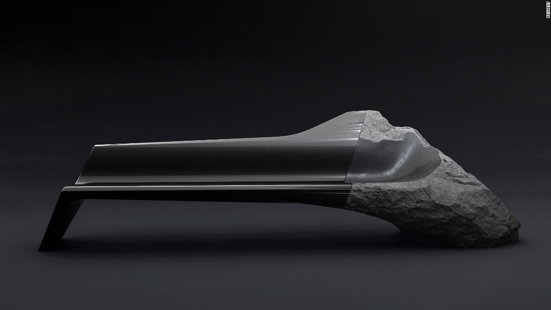 The Peugeot ONYX sofa was inspired by some of the French car maker's concept vehicles. It mixes man-made materials like carbon fiber with natural rock and stone.