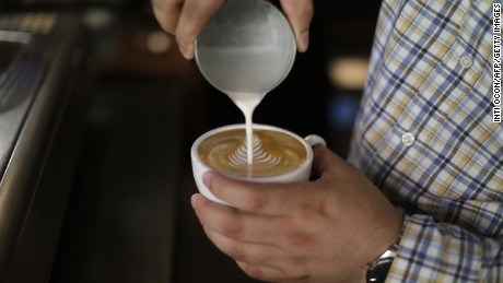 "A barista prepares a cappuccino coffee in a store in Matagalpa, some 130km from Managua on February 10, 2017. The ""robusta"" coffee, which is expanding in the fields of Nicaragua, is the alternative with which the country will try to cope with the battering of climate change and improve the profitability of the coffee production.  / AFP / INTI OCON / TO GO WITH AFP STORY by JULIA RIOS        (Photo credit should read INTI OCON/AFP/Getty Images)"
