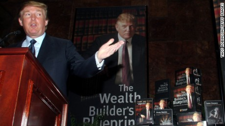 Real estate mogul Donald Trump gestures as he holds a media conference announcing the establishment of Trump University May 23, 2005 in New York City. Trump University will consist of on-line courses, CD-Roms and other learning programs for business professionals.