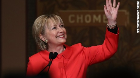 Former Secretary of State Hillary Clinton waves to students and guests while receiving a standing ovation before delivering remarks at Georgetown University on March 31, 2017 in Washington, DC.
