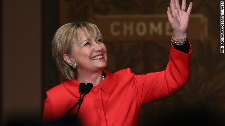 Former U.S. Secretary of State Hillary Clinton waves to students and guests while receiving a standing ovation before delivering remarks at Georgetown University March 31, 2017 in Washington, DC. Clinton spoke before presenting the 2017 Hillary Rodham Clinton Awards for Advancing Women in Peace and Security ceremony hosted by the Georgetown Institute for Women, Peace and Security.