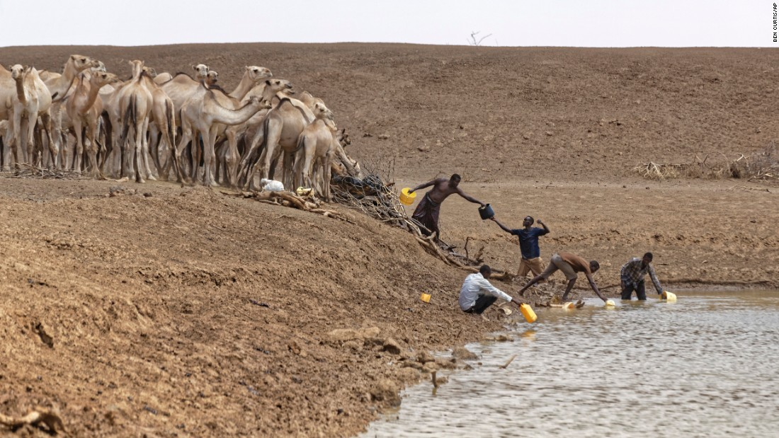 Kenyan camel herders scoop up water near the drought-affected village of Bandarero on Friday, March 3. Stephen O'Brien, the United Nations' humanitarian chief, toured the village and called on the international community to act.