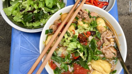 The first thing you'll notice about Bún riêu -- a meat or seafood vermicelli soup -- is its deep red color. The soup gets its hue from tomato paste and annatto seed -- from achiote tree seeds. The flavor is just as enticing, featuring chunks of crabmeat, fried tofu, tamarind paste, and light vermicelli noodles.