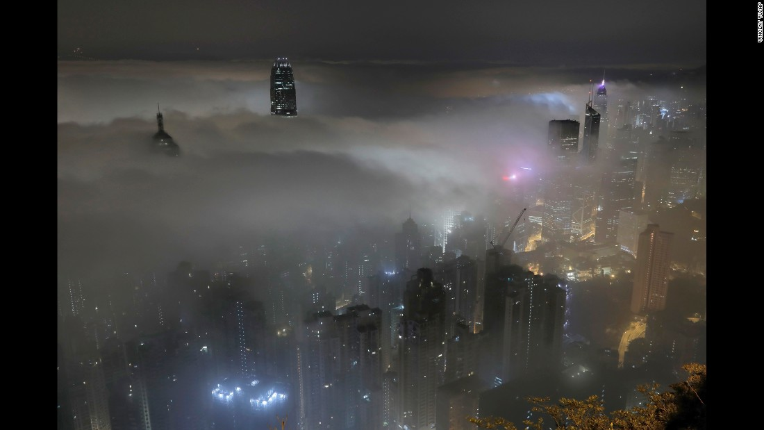 High-rise buildings are covered in fog at Hong Kong's Victoria Harbour on Monday, March 20.