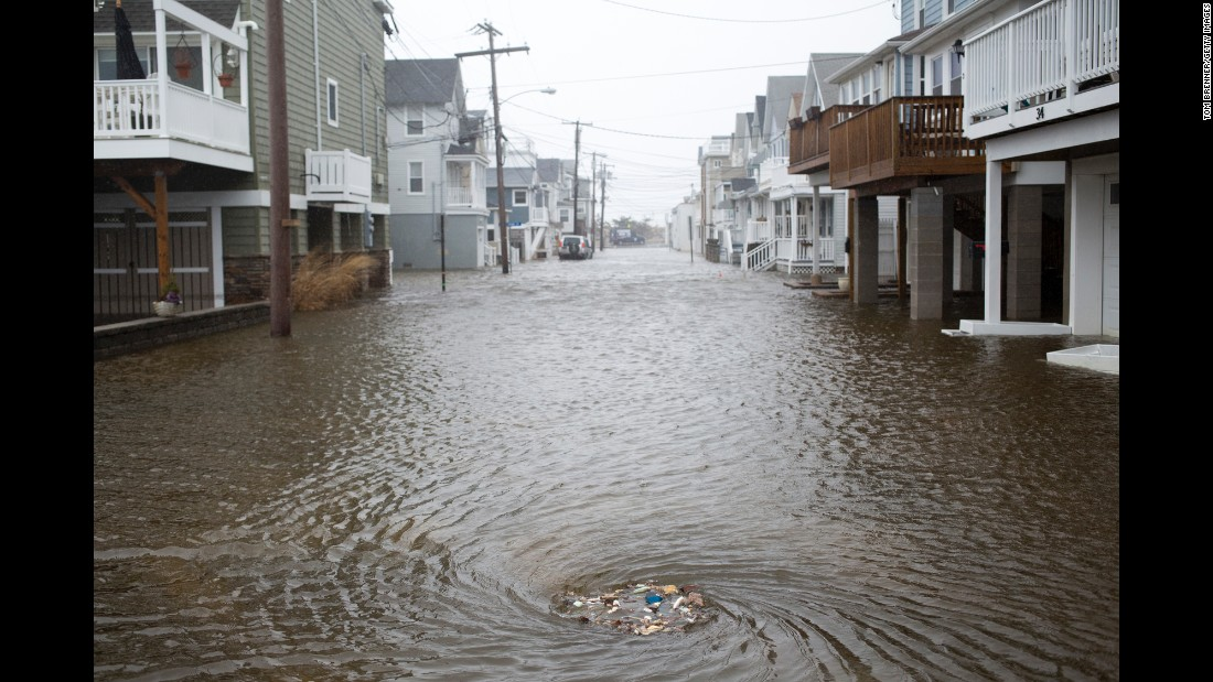 A sewage drain takes in garbage and water in Sea Bright, New Jersey, on Tuesday, March 14.