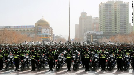 "This photo taken on February 27, 2017 shows Chinese police attending an anti-terrorist oath-taking rally in Hetian, northwest China's Xinjiang Uighur Autonomous Region.  Islamic State militants from China's Uighur ethnic minority have vowed to return home and ""shed blood like rivers"", according to a jihadist-tracking firm, in what experts said marked the first IS threat against Chinese targets. The threat came in a half-hour video released on February 27 by a division of the Islamic State in western Iraq and featuring militants from China's Uighur ethnic group, said the US-based SITE Intelligence Group, which analysed the footage. / AFP / STR / China OUT        (Photo credit should read STR/AFP/Getty Images)"