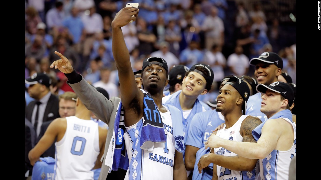 North Carolina basketball player Theo Pinson takes a selfie with teammates after they defeated Kentucky for a spot in the Final Four on Sunday, March 26.