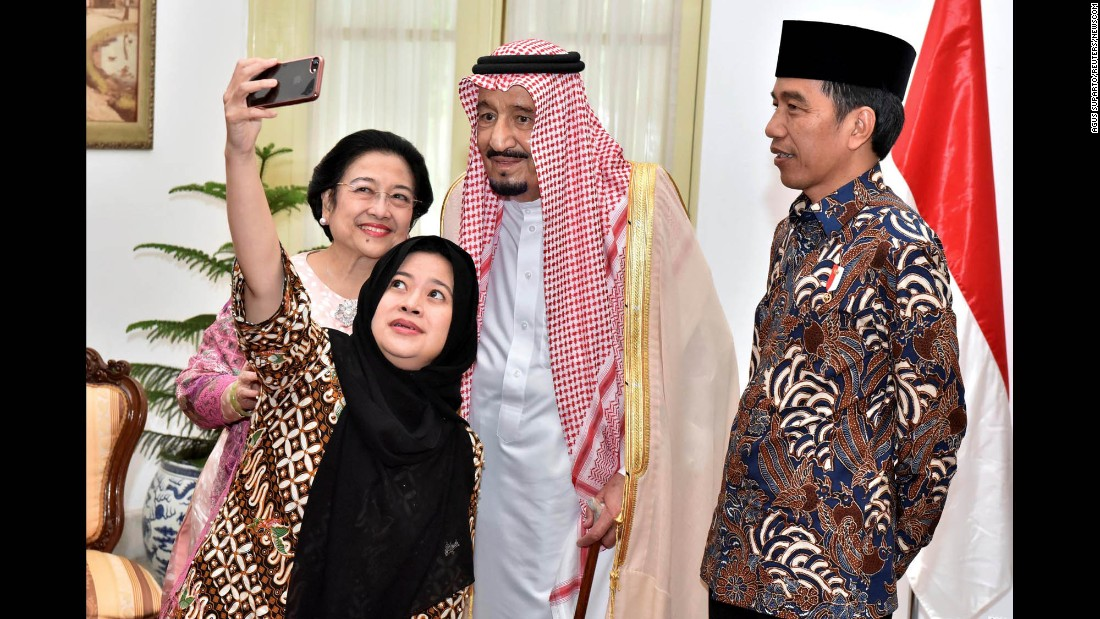 Indonesian President Joko Widodo, right, watches former president Megawati Sukarnoputri, left, pose for a selfie with her daughter, Puan Maharani, and Saudi King Salman on Thursday, March 2. King Salman was visiting the presidential palace in Jakarta, Indonesia.