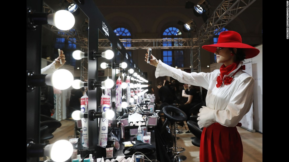 A model takes a backstage selfie before a Slava Zaitsev fashion show in Moscow on Sunday, March 12.