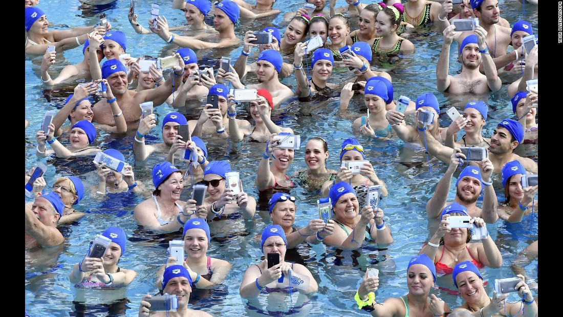 People in Budapest, Hungary, set a new national record for most people taking a water selfie at the same time on Sunday, March 19. There were 113 people in the outdoor pool.