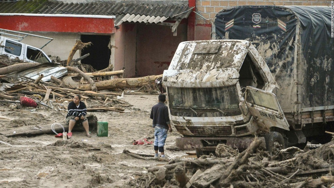 The day after a mudslide hit Mocoa, people walk among the devastation on  April 2.