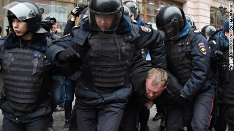 Russian police officers detain a man in central Moscow on April 2, 2017, as Russian opposition promised protests after police detained hundreds of people during anti-corruption rallies.
