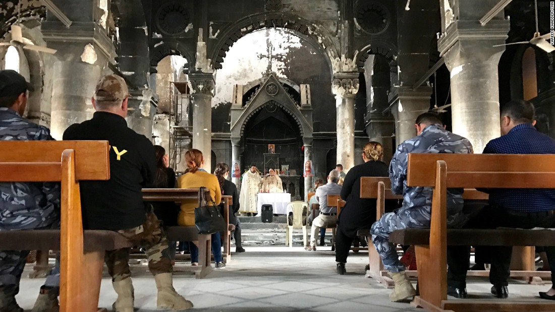 The Church of the Immaculate Conception was set on fire by ISIS, which turned its courtyards into a practice firing range. But priests held services in the church within weeks after the city was recaptured from ISIS.