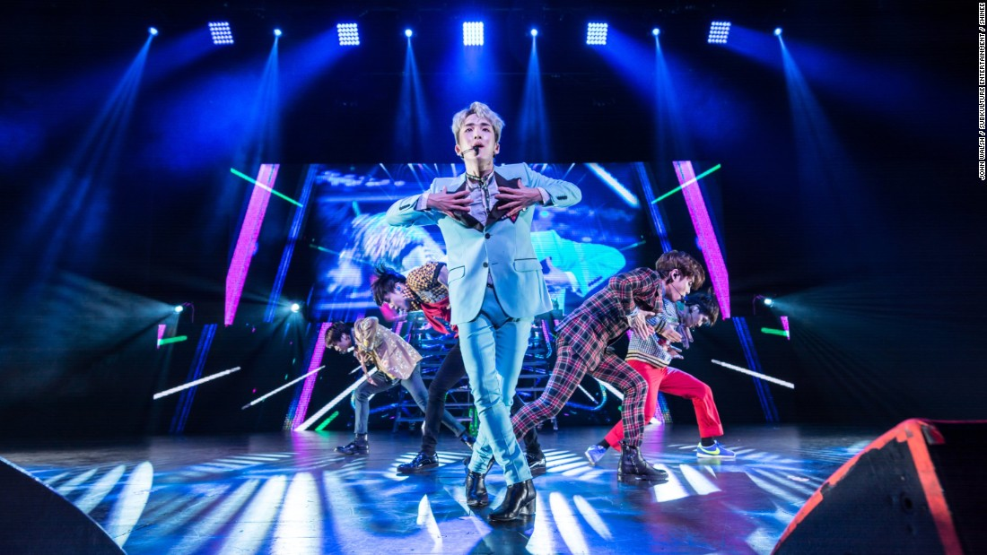 "Kim Ki Bum, known as ""Key,"" sings in the front of the rest of the SHINee band in Dallas."
