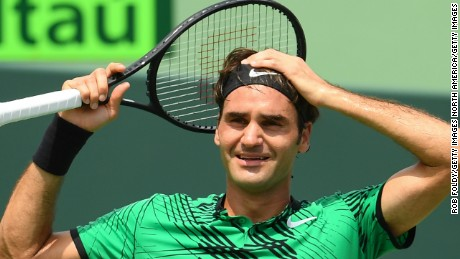 Roger Federer celebrates match point after defeating Rafael Nadal of Spain during the men's final of the Miami Open