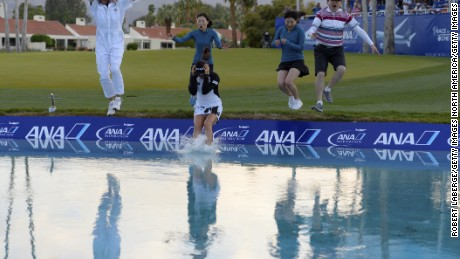 ANA Inspiraton winner So Yeon Ryu jumped in Poppie's Pond with her family and caddie Tom Watson as per the tournament's custom.
