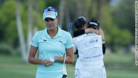 RANCHO MIRAGE, CA - APRIL 02:  Lexi Thompson (L) walks off the 18th green, as So Yeon Ryu of the Republic of Korea celebrates with her caddie after Ryu defeated Thompson in a playoff during the final round of the ANA Inspiration at the Dinah Shore Tournament Course at Mission Hills Country Club on April 2, 2017 in Rancho Mirage, California.  (Photo by Jeff Gross/Getty Images)